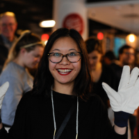 Smiling woman with gloves on