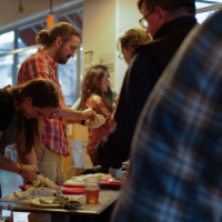 People learning to shuck oysters