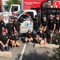 Group of volunteers in front of shell recycling truck