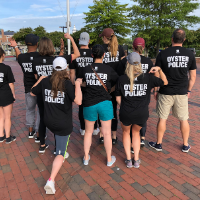 Volunteers posing with OYSTER POLICE t-shirts
