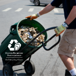 ORP Shell Recycling Alliance - Man carts can of recycled oyster shell to be used in large scale oyster sanctuary restoration