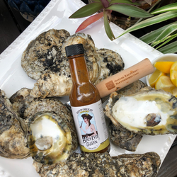 Black Eyed Susan Spice Co Death by Chocolate hot sauce surrounded by oysters
